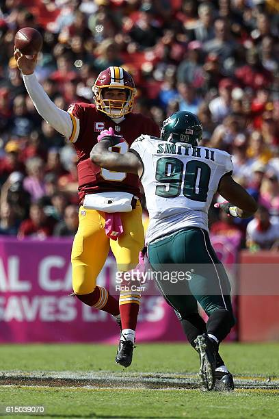 Quarterback Kirk Cousins of the Washington Redskins passes the ball against defensive end Marcus Smith of the Philadelphia Eagles in the second...