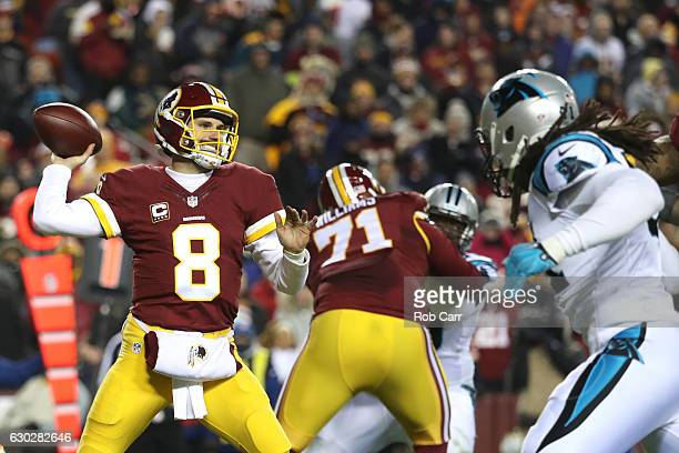 Quarterback Kirk Cousins of the Washington Redskins passes the ball while teammate tackle Trent Williams of the Washington Redskins blocks against...