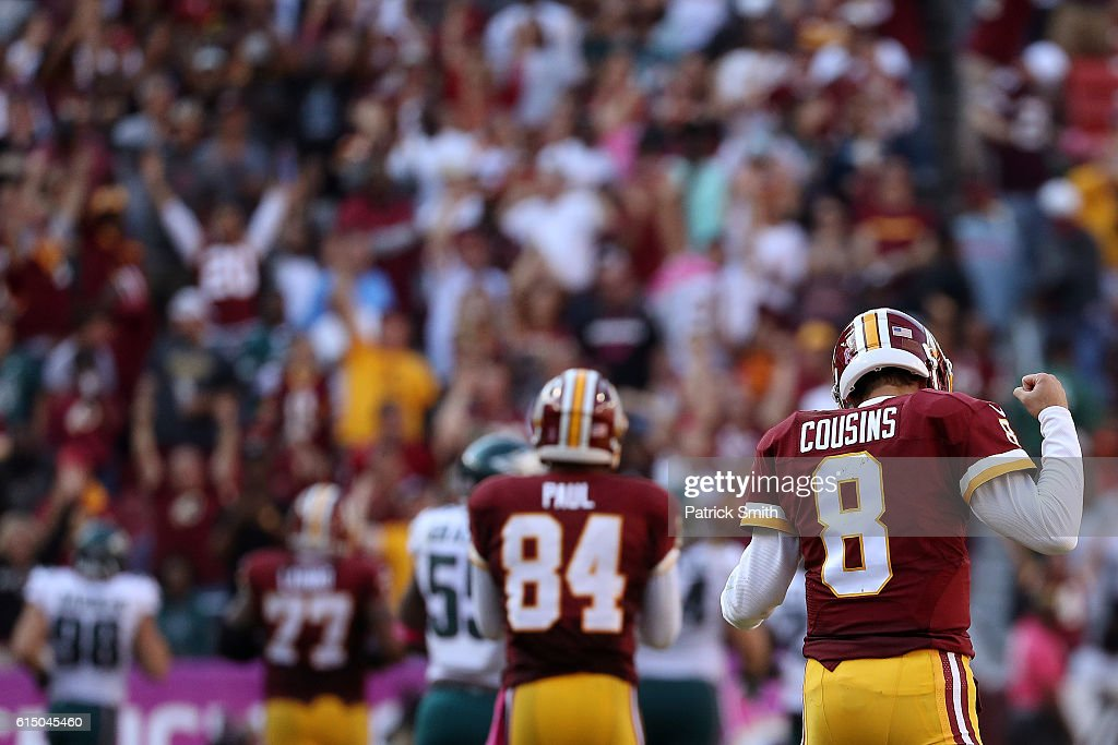 Quarterback Kirk Cousins #8 of the Washington Redskins reacts after teammate running back Matt Jones #31 carried the ball for 57 yards against the Philadelphia Eagles in the fourth quarter at FedExField on October 16, 2016 in Landover, Maryland.