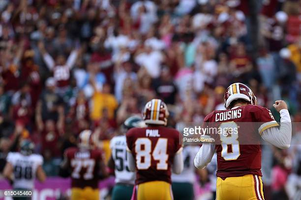Quarterback Kirk Cousins of the Washington Redskins reacts after teammate running back Matt Jones carried the ball for 57 yards against the...