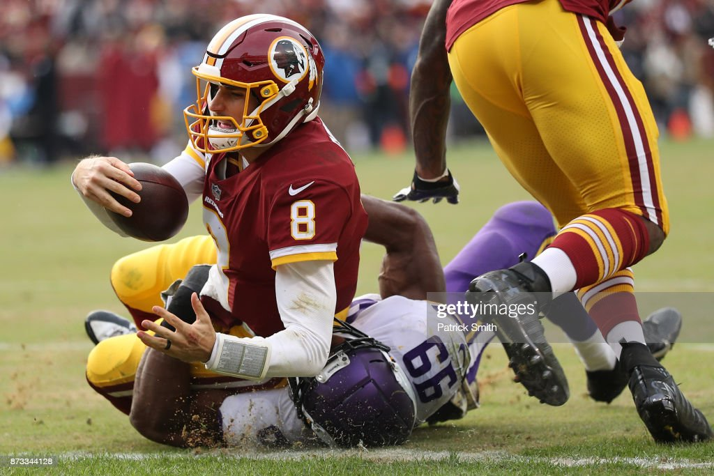 Quarterback Kirk Cousins #8 of the Washington Redskins runs for a touchdown during the fourth quarter against the Minnesota Vikings at FedExField on November 12, 2017 in Landover, Maryland.