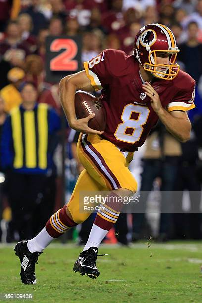 Quarterback Kirk Cousins of the Washington Redskins runs with the ball during a game against the New York Giants at FedExField on September 25 2014...