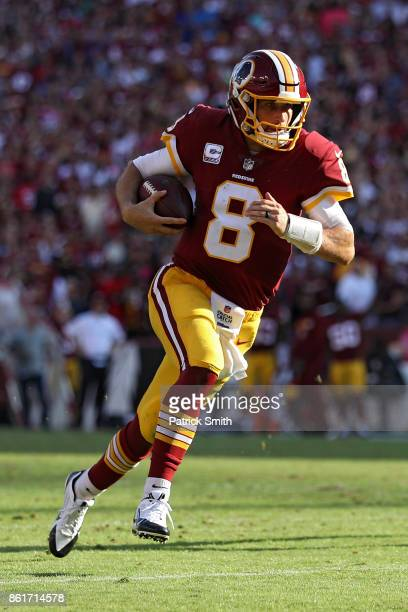 Quarterback Kirk Cousins of the Washington Redskins rushes to score a touchdown against the San Francisco 49ers during the fourth quarter at...