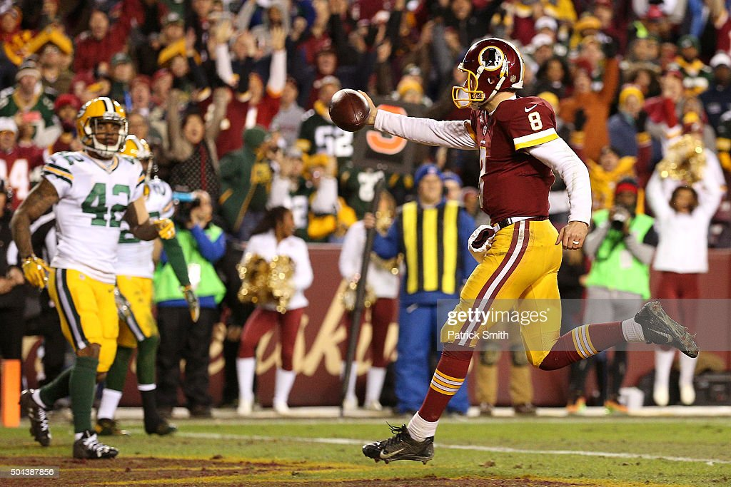 Quarterback Kirk Cousins #8 of the Washington Redskins scores a third-quarter touchdown against strong safety Morgan Burnett #42 of the Green Bay Packers during the NFC Wild Card Playoff game at FedExField on January 10, 2016 in Landover, Maryland.