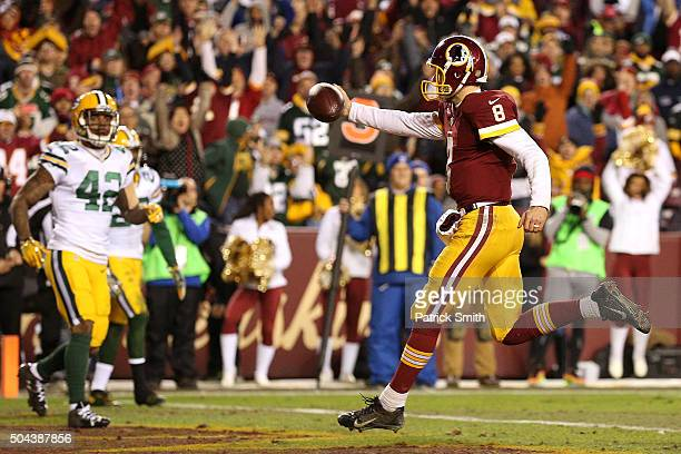 Quarterback Kirk Cousins of the Washington Redskins scores a thirdquarter touchdown against strong safety Morgan Burnett of the Green Bay Packers...