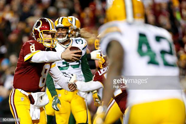 Quarterback Kirk Cousins of the Washington Redskins scores a third quarter touchdown past strong safety Micah Hyde of the Green Bay Packers during...