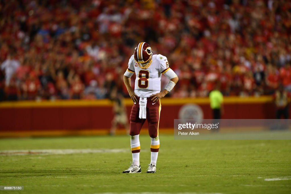 Quarterback Kirk Cousins #8 of the Washington Redskins stands disappointed after a communication issue forced a time out during the fourth quarter of the game against the Kansas City Chiefs at Arrowhead Stadium on October 2, 2017 in Kansas City, Missouri.