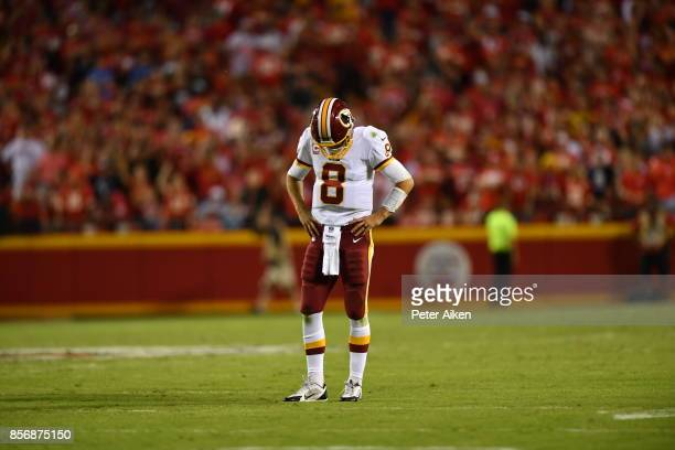 Quarterback Kirk Cousins of the Washington Redskins stands disappointed after a communication issue forced a time out during the fourth quarter of...