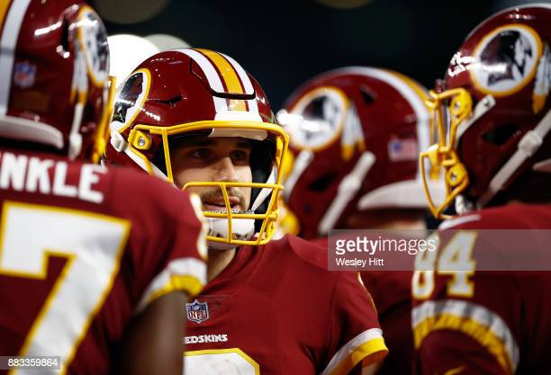 Quarterback Kirk Cousins of the Washington Redskins stands in the huddle in the first quarter of a football game against the Dallas Cowboys at ATT...