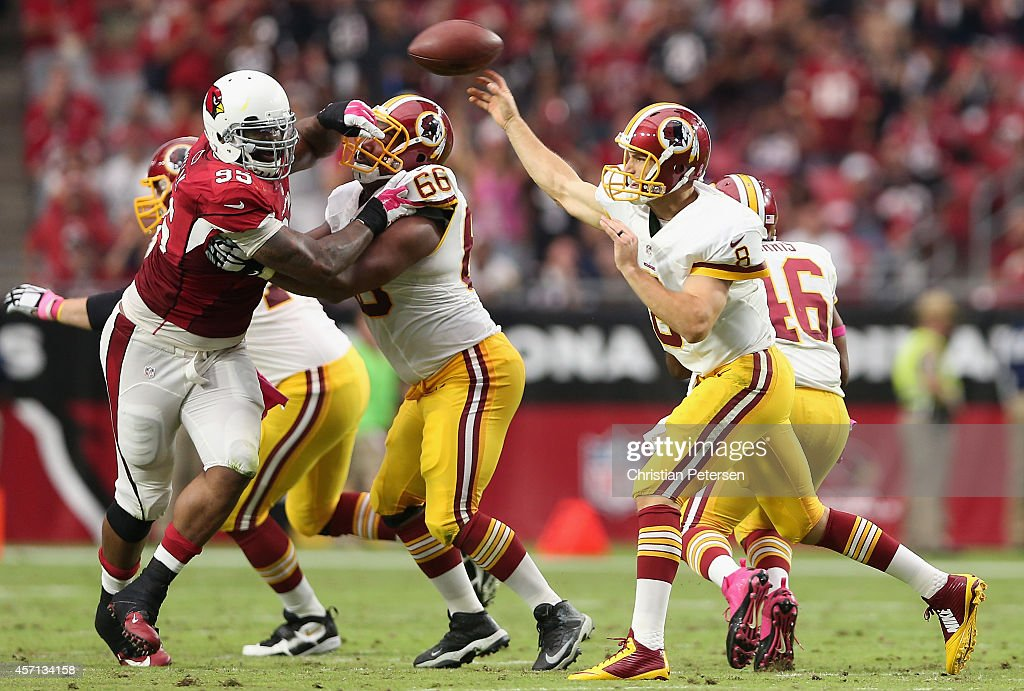 Quarterback Kirk Cousins #8 of the Washington Redskins throws a pass during the second half of the NFL game against the Arizona Cardinals at the University of Phoenix Stadium on October 12, 2014 in Glendale, Arizona. The Cardinals defeated the Redskins 30-20.