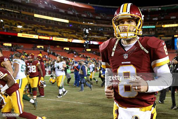 Quarterback Kirk Cousins of the Washington Redskins walks off of the field after the Green Bay Packers defeated the Washington Redskins 3518 during...