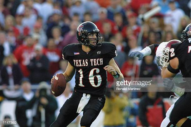 Quarterback Kliff Kingsbury of Texas Tech drops back to pass against Oklahoma during the game on November 17 2001 at Jones SBC Stadium in Lubbock...