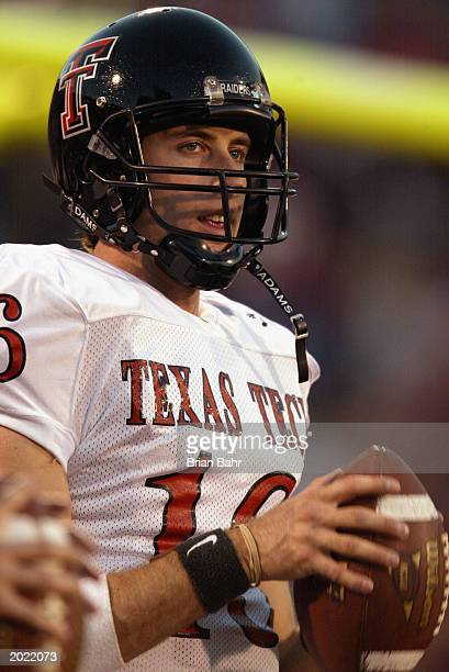 Quarterback Kliff Kingsbury of the Texas Tech University Red Raiders holds the ball during the game against the University of Oklahoma Sooners at...