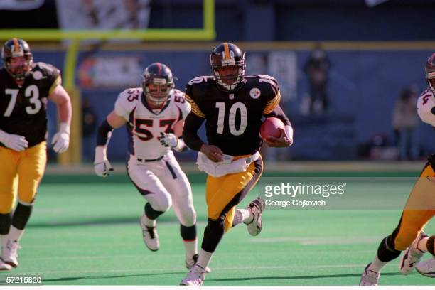 Quarterback Kordell Stewart of the Pittsburgh Steelers runs against the Denver Broncos during a playoff game at Three Rivers Stadium on January 11...