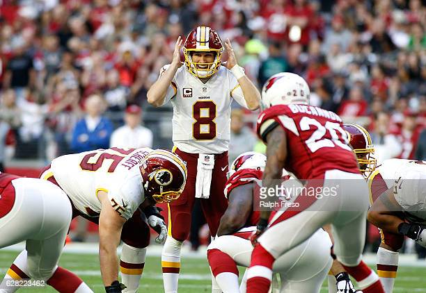 Quarterback Kurk Cousins of the Washington Redskins signals a play at the line of scrimmage during the third quarter of a game against the Arizona...