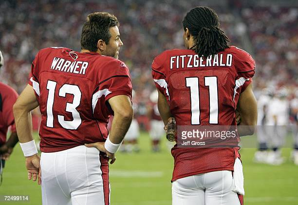 Quarterback Kurt Warner and Larry Fitzgerald of the Arizona Cardinals talk on the sidelines during the game against the Denver Broncos on August 31...