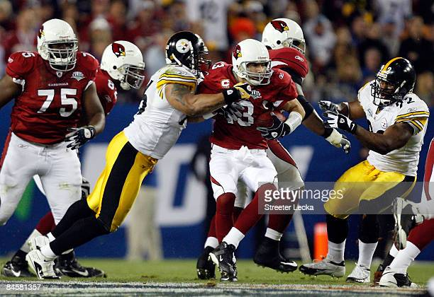 Quarterback Kurt Warner of the Arizona Cardinals is sacked by LaMarr Woodley of the Pittsburgh Steelers during Super Bowl XLIII on February 1, 2009...