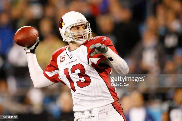 Quarterback Kurt Warner of the Arizona Cardinals looks to pass against the Carolina Panthers during the NFC Divisional Playoff Game on January 10...