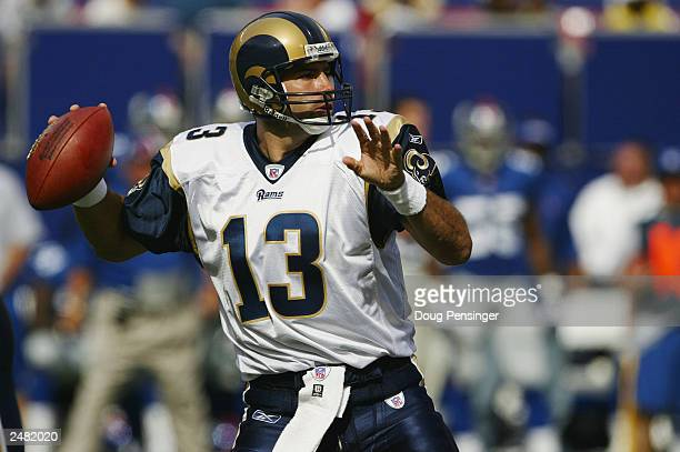 Quarterback Kurt Warner of the St Louis Rams throws a pass against the New York Giants during the game at the Giants Stadium on September 7 2003 in...