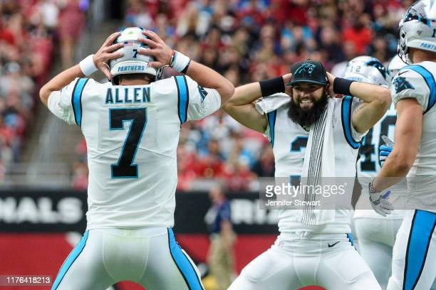 Quarterback Kyle Allen of the Carolina Panthers celebrates a touchdown with quarterback Will Grier in the first half of the NFL game against the...