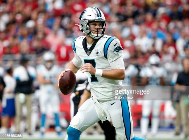 Quarterback Kyle Allen of the Carolina Panthers looks to pass against the Arizona Cardinals during the first half of the NFL football game at State...