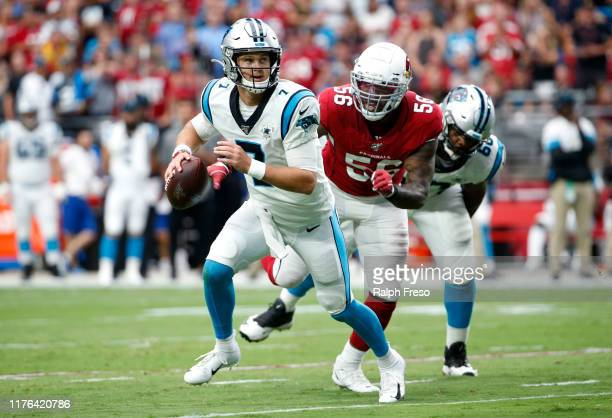 Quarterback Kyle Allen of the Carolina Panthers scrambles away from linebacker Terrell Suggs of of the Arizona Cardinals during the first half of the...