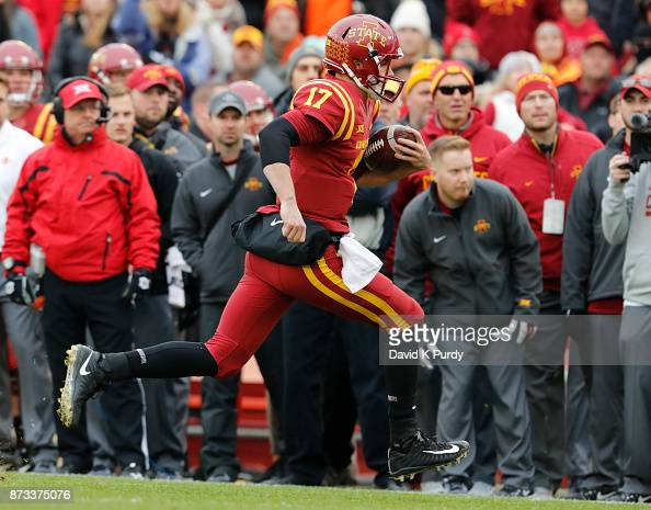 quarterback kyle kempt of the iowa state cyclones scrambles for