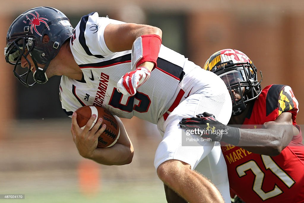 Quarterback Kyle Lauletta #5 of the Richmond Spiders is tackled by defensive back Sean Davis #21 of the Maryland Terrapins in the second half at Byrd Stadium on September 5, 2015 in College Park, Maryland. The Maryland Terrapins won, 50-21.