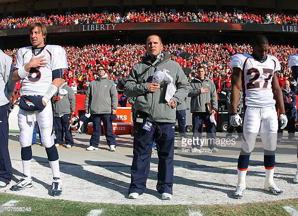 Quarterback Kyle Orton head coach Josh McDaniels and running back Knowshon Moreno of the Denver Broncos observe the national anthem before a game...