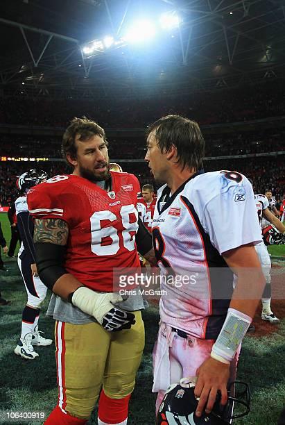 Quarterback Kyle Orton of Denver Broncos and Adam Snyder of San Francisco 49ers talk after the NFL International Series match between Denver Broncos...