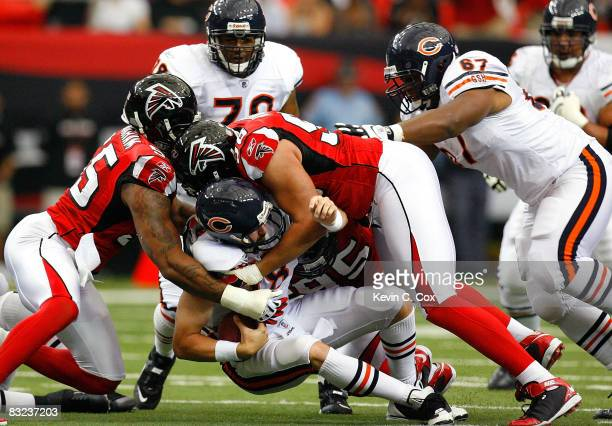 Quarterback Kyle Orton of the Chicago Bears is sacked by John Abraham and Jamaal Anderson of the Atlanta Falcons during the game at the Georgia Dome...
