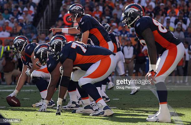 Quarterback Kyle Orton of the Denver Broncos runs the offense against the Indianapolis Colts at INVESCO Field at Mile High on September 26 2010 in...