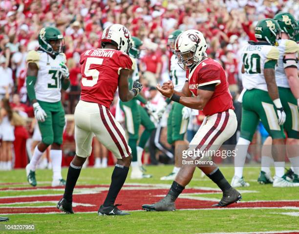 Quarterback Kyler Murray and wide receiver Marquise Brown of the Oklahoma Sooners celebrate a touchdown against the Baylor Bears at Gaylord Family...