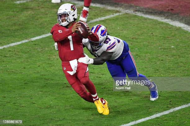 Quarterback Kyler Murray of the Arizona Cardinals breaks a tackle by defensive end of the Buffalo Bills just before throwing a game-winning touchdown...