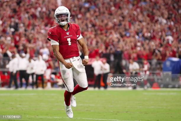 Quarterback Kyler Murray of the Arizona Cardinals celebrates after converting a two-point conversion against the Detroit Lions during the final...