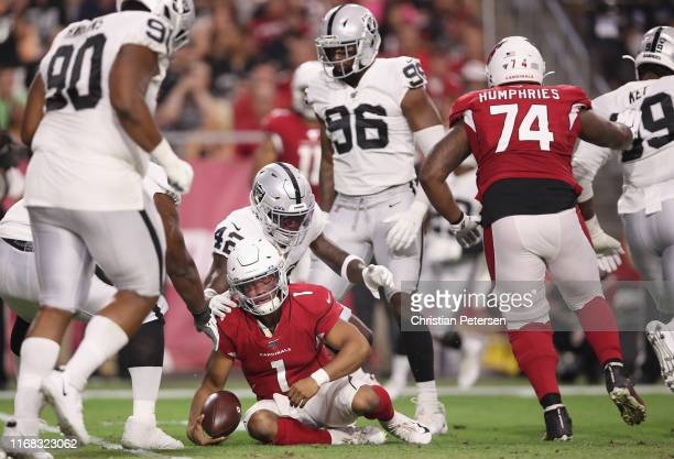 Quarterback Kyler Murray of the Arizona Cardinals is brought down by free safety Karl Joseph of the Oakland Raiders during the first half of the NFL...
