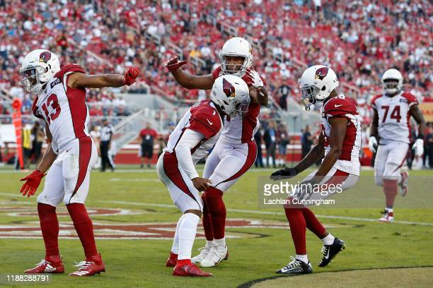 Quarterback Kyler Murray of the Arizona Cardinals is congratulated by KeeSean Johnson Larry Fitzgerald and Christian Kirk after scoring on a 22...