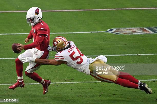 Quarterback Kyler Murray of the Arizona Cardinals is forced out of bounds by linebacker Fred Warner of the San Francisco 49ers during the second half...