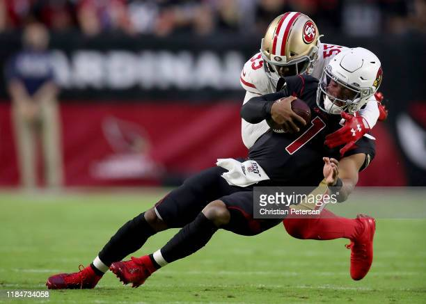Quarterback Kyler Murray of the Arizona Cardinals is tackled by defensive end Dee Ford of the San Francisco 49ers Ford was penalized for the horse...