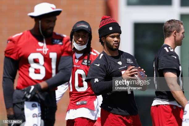 Quarterback Kyler Murray of the Arizona Cardinals participates in an off-season workout at Dignity Health Arizona Cardinals Training Center on June...
