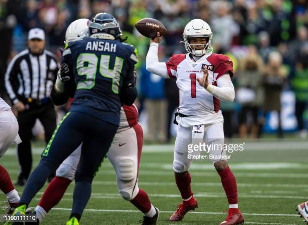 Quarterback Kyler Murray of the Arizona Cardinals passes the ball as defensive end Ziggy Ansah of the Seattle Seahawks rushes the passer during the...