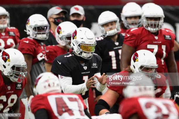 Quarterback Kyler Murray of the Arizona Cardinals prepares to take a snap during the Red & White Practice at State Farm Stadium on August 28, 2020 in...