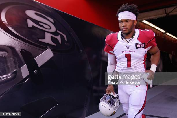Quarterback Kyler Murray of the Arizona Cardinals runs onto the field before the NFL game against the San Francisco 49ers at Levi's Stadium on...