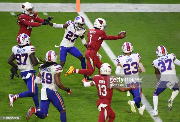 Quarterback Kyler Murray of the Arizona Cardinals scores a rushing touchdown during the second half against the Buffalo Bills at State Farm Stadium...