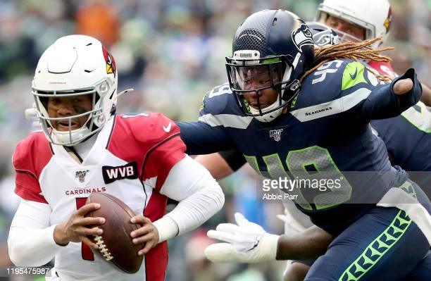 Quarterback Kyler Murray of the Arizona Cardinals scrambles against pressure from outside linebacker Shaquem Griffin of the Seattle Seahawks during...