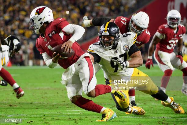 Quarterback Kyler Murray of the Arizona Cardinals scrambles under pressure from defensive end Cameron Heyward of the Pittsburgh Steelers in the...