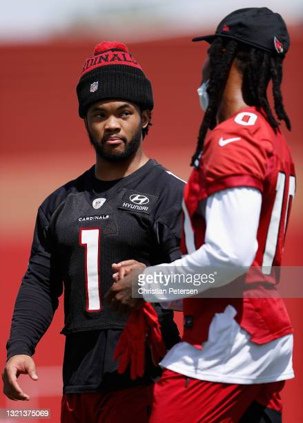 Quarterback Kyler Murray of the Arizona Cardinals talks with wide receiver DeAndre Hopkins in an off-season workout at Dignity Health Arizona...