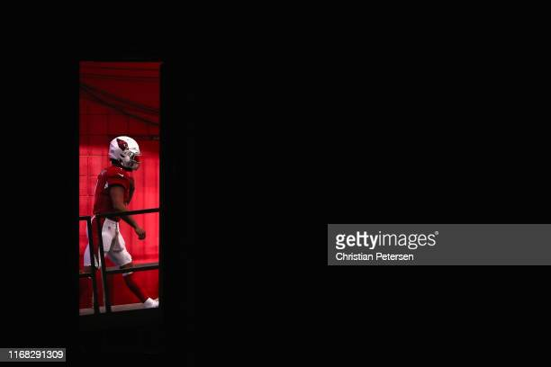 Quarterback Kyler Murray of the Arizona Cardinals walks out to the field for warm ups before the NFL preseason game against the Oakland Raiders at...