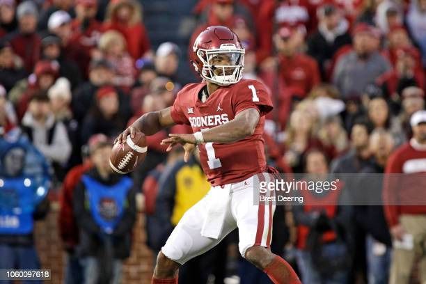 Quarterback Kyler Murray of the Oklahoma Sooners looks to throw against the Oklahoma State Cowboys at Gaylord Family Oklahoma Memorial Stadium on...