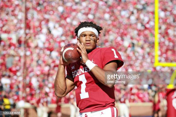 Quarterback Kyler Murray of the Oklahoma Sooners warms up on the sidelines during the game against the Kansas State Wildcats at Gaylord Family...